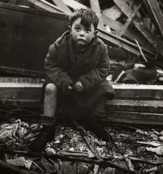 abandoned_boy_holding_a_stuffed_toy_animal_amid_ruins_following_german_aerial_bombing_of_london_1940